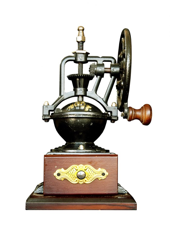 Vintage coffee grinder isolate on white background
